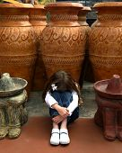 Young cacausian girl imitating sleeping Mexican ceramic statues poster