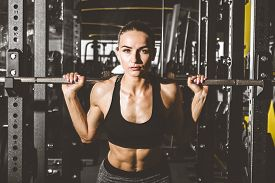 Working Out With Barbell Weights At The Gym.fitness Women Exercising Are Lifting Dumbbells. Fitness