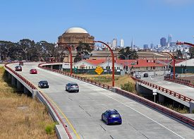 Road With Cars With San Francisco Cityscape In Far Background.