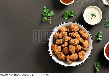 Crispy Fried Breaded Chicken Bites In Bowl Over Brown Background With Copy Space. Tasty Chicken Nugg