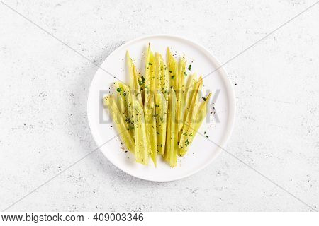 Braised Celery On Plate Over Light Stone Background With Free Text Space. Top View, Flat Lay