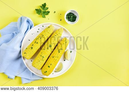 Boiled Corn Cobs On Plate Over Yellow Background With Free Text Space. Top View, Flat Lay
