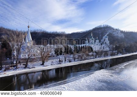 Church Svyatohirsk Lavra Over The River Siversky Donets In Winter. There Is No Ice In The Middle Of