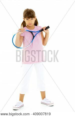 Happy Playful Girl Smiling On The Tennis Court With A Racket. Little Girl With A Tennis Racket In A