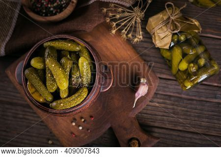 Homemade Canning. Marinated Cucumbers Gherkins With Dill And Garlic In A Glass Jar On A Dark Wooden