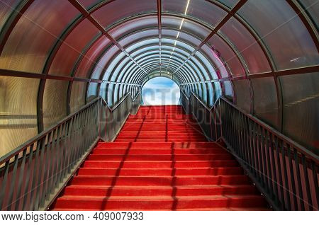 Red Staircase With Arched Roof. Ascending Forward To The Sky. Modern Architecture Concept