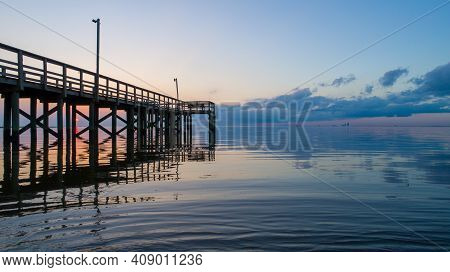 Bayfront Park Pier On Mobile Bay, Alabama At Sunset In February Of 2021