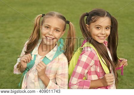 Ending Of School Year. Cheerful Smart Schoolgirls. Happy Schoolgirls Outdoors. Small Schoolgirls Wit