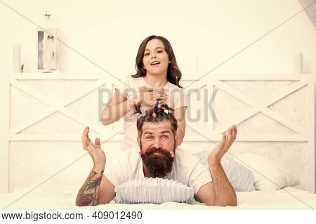 Free Time. Togetherness. Spending Time Together At Home. Little Girl Made Funny Hairstyle For Daddy.