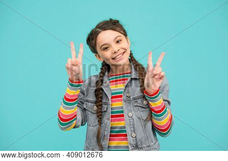 Staying Cool And Fabulous. Happy Child Show V Signs Blue Background. Little Girl With Cool Look. Fas