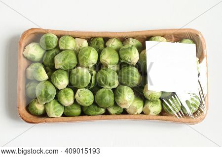The Heads Of Brussels Sprouts Are Randomly Placed In A Cardboard Box And Covered With Transparent Fo