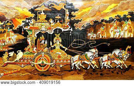 Hyderabad,india-september 15,2019 : View Of Wooden Art Of Hindu God Krishna Teaching Bhavad Gita Dur