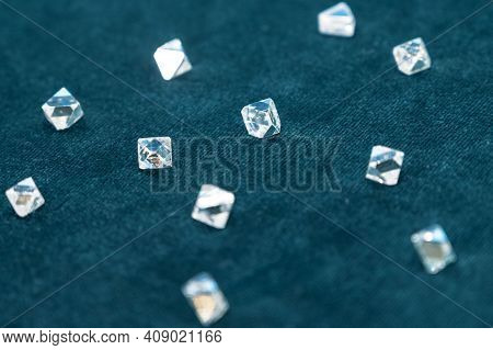 Several Large Diamonds Lie On The Turquoise Velvet. Close-up Photo. Cut Diamond.