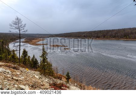The Banks Of A Wide Taiga River. Irelyakh River, Yakutia Russia.