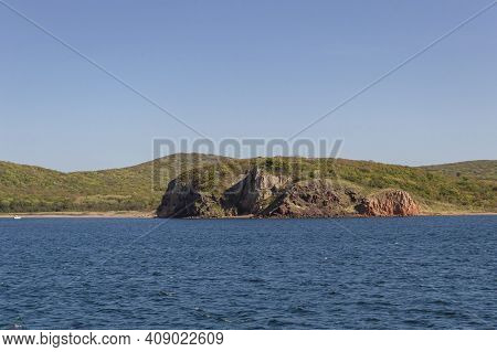 Rugged Coastline Of Russkiy Island On Sunny Day From The Japanese Sea