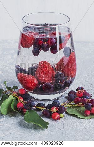 Fresh Cool Detox Drink With Various Berries. Glass Of Lemonade Or Flavored Infuse Water, Tea. Proper