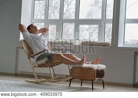 Joy Of Life. Total Relaxation. Handsome Young Man Keeping Eyes Closed And Holding Hands Behind Head