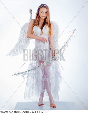 Cupid Girl Aiming At Someone With An Arrow Of Love. Arrow Of Love. Valentines Day Cupid. St Valentin