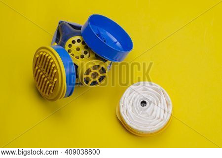 Industrial Respirator With Replaceable Filters On Yellow Background. Special Semi-mask-type Personal