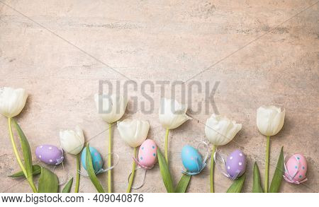 Easter Eggs And White  Tulips On Gray Background. Top View Flat Lay. Happy Easter Concept. Spring Ea