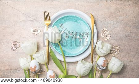 Easter Table Setting With Floral Decor On Grey Table. Elegance Dinner. Top View. Happy Easter Backgr