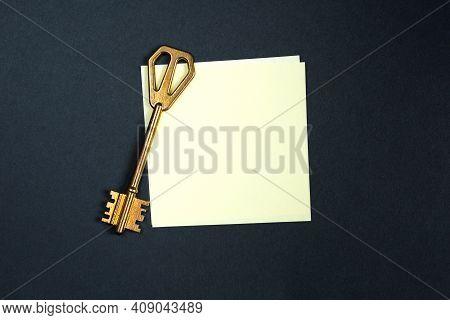 A Golden Key On A Piece Of Note Paper. Wish List, Problem Solution, Idea, Decoding, Business Concept