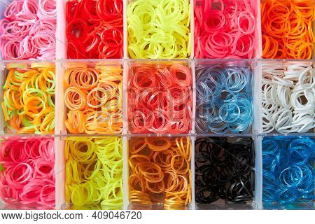 A Set Of Colorful Rubber Bands And Loom Knit For Knitting Wristbands.
