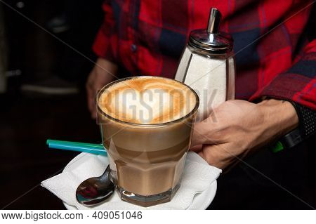 The Waiter Holds A Coffee Frappe With A Heart Drawn On The Foam. Close-up, Selective Focus