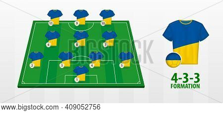 Ukraine National Football Team Formation On Football Field. Half Green Field With Soccer Jerseys Of