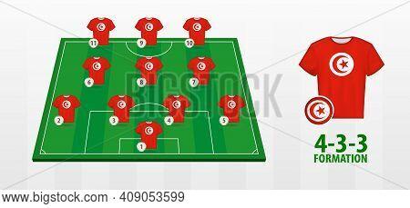 Tunisia National Football Team Formation On Football Field. Half Green Field With Soccer Jerseys Of