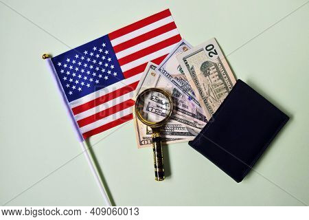 American Flag, Magnifier And Dollar Bills In Wallet On Green Background. Studio Photography Of Ameri