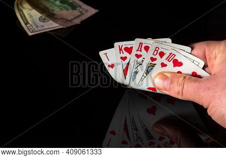 Poker Cards With A Royal Flush Combination. Close Up Of A Gambler Hand Is Holding Playing Cards In C