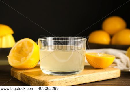 Freshly Squeezed Lemon Juice In Glass Bowl On Table