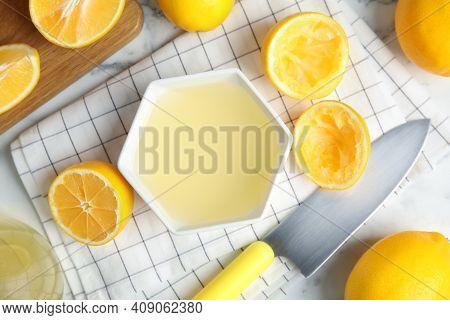 Freshly Squeezed Lemon Juice On Light Table, Flat Lay