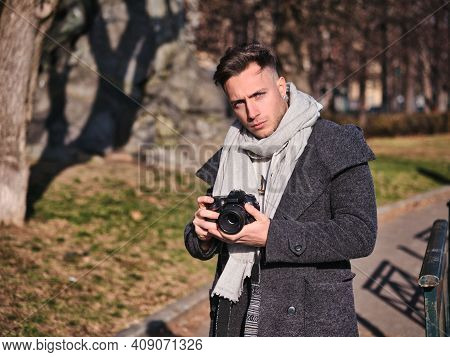 Handsome Young Male Photographer Taking Photograph Outside