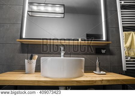 Bathroom Interior With Grey Tile On A Wall, Stylish Round Sink And Tap On A Oak Wood Worktop. Minima