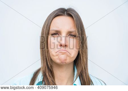 Close Up Portrait Of Sad Unhappy And Disappointed Woman Face. Facial Expression Of Feeling Sadness