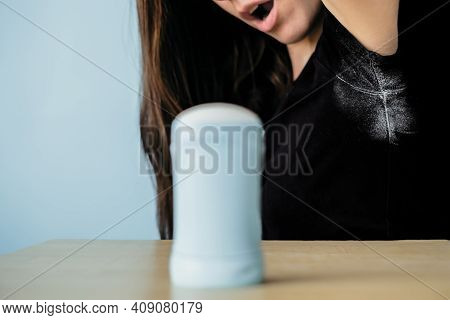 Girl Surprising By Deodorant Stains On Black Clothes. High Quality Photo
