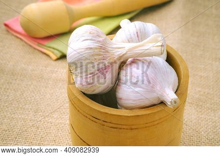 Garlic Bulbs Close-up In A Wooden Bowl.