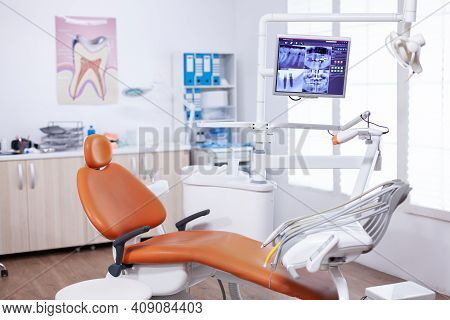 Radiography Of Patient Jaw On Screen Display In Dentist Office. Stomatology Equipment In Dental Priv