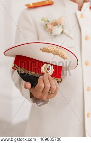 A Sailor's Hat In The Captain's Hands. Headdress.