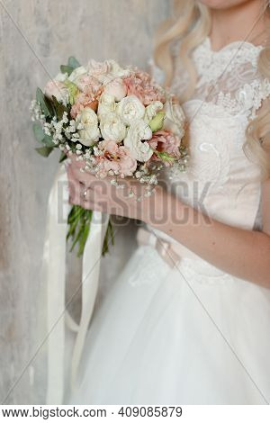 Wedding Bouquet In The Hands Of The Bride.