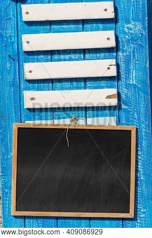 Closeup Of A Wooden Blank Billboard And Empty Blackboard With Copy Space. Template For A Bar, Restau