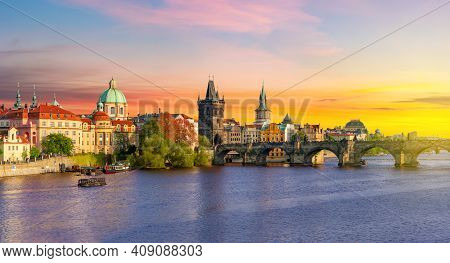 Classic Prague Panorama With Old Town Bridge Tower And Charles Bridge Over Vltava River At Sunset, C