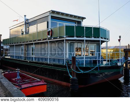 Creative Self Built Floating Hous Boat On A Platform Of Old Metal Raft
