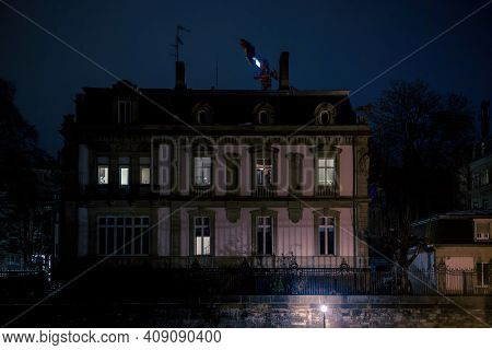 Beautiful Private Villa Apartment Building With Few Lights Turned On And Construction Crane Above Th