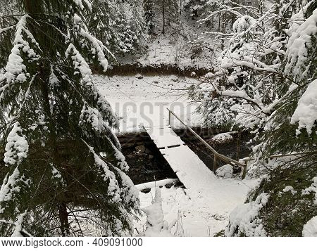 Mountain River In The Winter Forest. Mountain River Stream In A Snowy Forest. Source Of Water In The