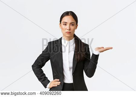 Serious-looking Determined Young Asian Businesswoman Introduce Her Project, Showing Something On Pal