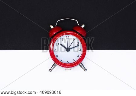 Red Round Analog Alarm Clock Isolated On Black White Background. Time 10:10. Space For Text.
