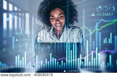 Attractive Smiling African American Business Woman Or Stock Trader Analyzing Stock Graph Chart Using